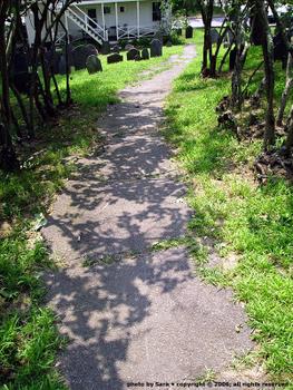Asphalt path downhill.