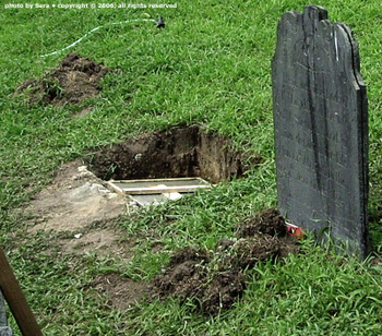 Hole with new headstone base.