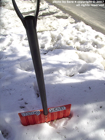 Snow shovel labeled 'Visitor's Shovel.'