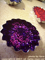 Flower-shaped candy mold filled with resin.