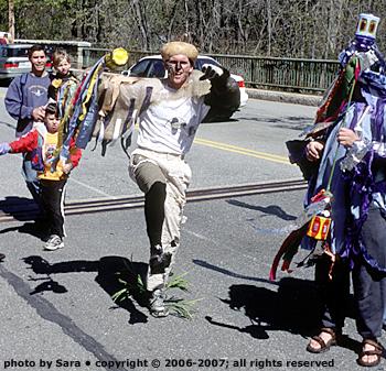 Acorn man parading festively.