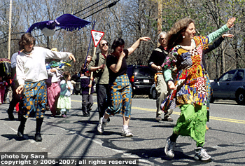 Dancers dancing while parading.