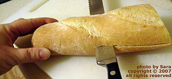 Slicing sub bread lengthwise.