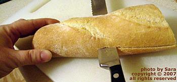 Slicing sub bread lengthwise.