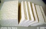 Raw block of naked tofu, sliced.