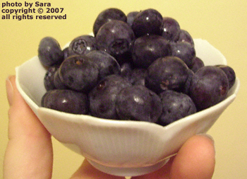 Precious little white Japanese bowl full of blueberries.