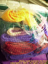 Scarves I've crocheted, awaiting shipment.