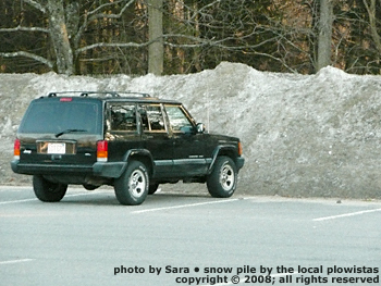 Pile of old plowed snow, higher than a Jeep and not going anywhere.