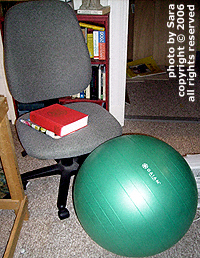 Ball next to studio chair.