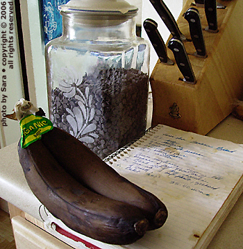 Age-blackened bananas on a messy cookbook.