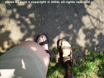 Inching down the path sideways, prosthetic foot first.