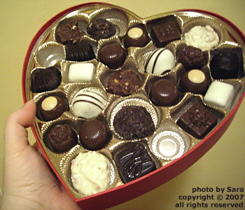 Disappearing chocolates inside the satin box.