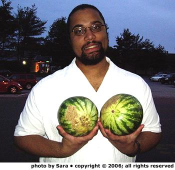 John holding melons.