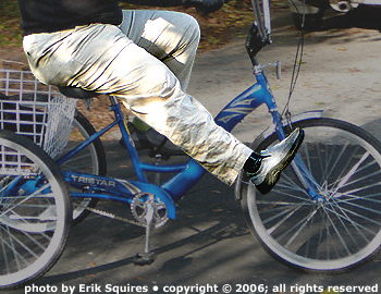 Prosthetic leg straightened while cycling, side view.