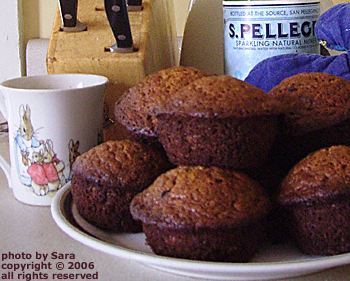 Plate of freshly baked banana chocolate chip muffins.