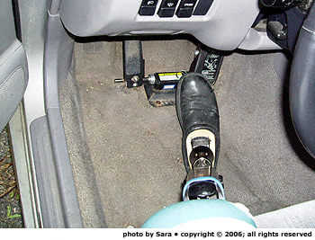 Entering car on driver's side, prosthetic leg first.